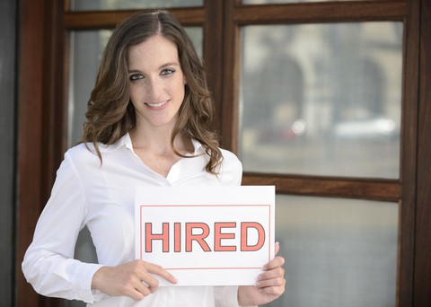 http://www.dreamstime.com/stock-image-recruitment-woman-holding-hired-sign-image26412331
